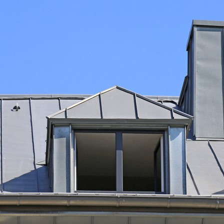 metal roof with an outcropping