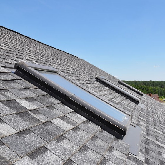 Shingles asphalt roofing with skylights