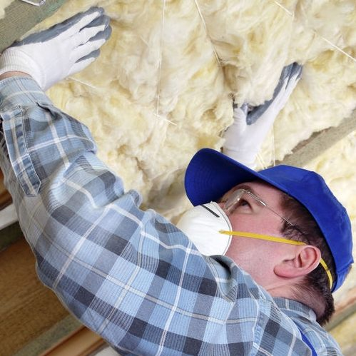 A Picture of a Man Insulating a Roof Using Mineral Wool.