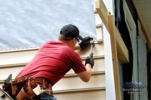 Contractor Installing Siding
